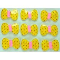 23-1 кабошон бантик 50шт размер 2х1,3см (желтые)